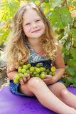 Blonde curly child girl with bunch of grapes Stock Photography
