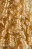 Blonde curly hair. As a background Royalty Free Stock Photos