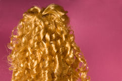 Blonde curly hair. With pink background Stock Image