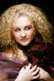 Blonde with curly hair Stock Image