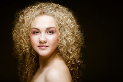 Blonde with curly hair Stock Images