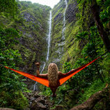 Blonde Curly Haired Woman on Orange Hammock Distance Waterfalls Duringdaytime Stock Images