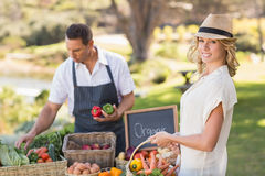 Blonde customer buying some vegetables Stock Image