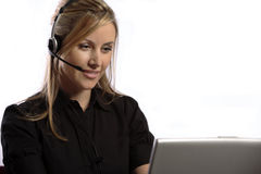 Blonde customer service lady with headset. Blonde lady talking on headset performing customer service on a cordless headset phone Stock Photography
