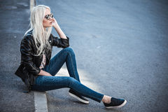 Blonde cute model posing outdoors Stock Photography