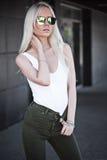 Blonde cute model posing outdoors Royalty Free Stock Image