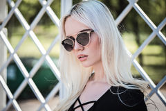 Blonde cute model posing outdoors Royalty Free Stock Photo