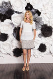 Blonde cute slim fit business woman in grey skirt smiling. black Royalty Free Stock Image