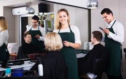 Blonde cuts hair at salon Royalty Free Stock Photo