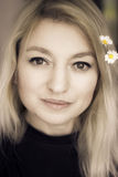 Blonde and daisies. Blond woman with daisies in hair stock photo