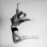 Blonde dancer, ballerina on grey background stock photography