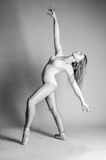 Blonde dancer, ballerina on grey background royalty free stock image