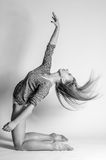 Blonde dancer, ballerina on grey background stock images