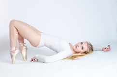 Blonde dancer, ballerina on white background stock image