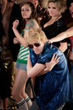 Blonde dancer in blue shirt Stock Photography