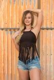 Blonde dans brun et bleu photo libre de droits