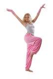 Blonde dans des vêtements roses Image stock