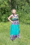Blonde dans une robe Photographie stock