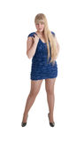 Blonde in a dark blue dress Stock Image