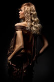 Blonde in darkness Royalty Free Stock Images