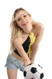 Blonde de la belleza con el balón de fútbol Imagen de archivo libre de regalías