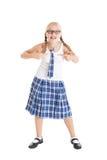 Blonde de la colegiala con dos trenzas que llevan un uniforme escolar y vidrios negro-enmarcados. Imagen de archivo libre de regalías