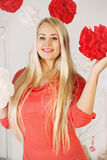 Blonde with decorative paper balloons Royalty Free Stock Photography