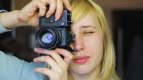 Blonde with different eyes shoots on an old retro camera, heterochromia stock video
