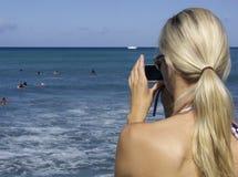 Blonde digital camera stock photography