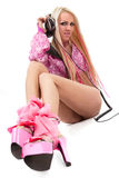 Blonde dj in pink suit with a headphone Stock Images