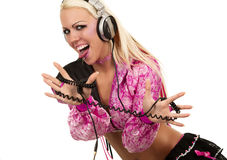 Blonde dj in pink suit with a headphone Royalty Free Stock Photo
