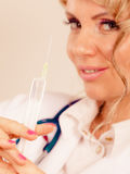 Blonde doctor with syringe. Royalty Free Stock Images