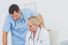 Blonde doctor working with her colleague Royalty Free Stock Images