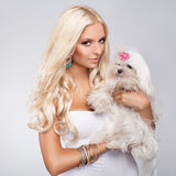 Blonde with dog Stock Images