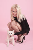 The blonde with the doggie Stock Photography