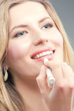 Blonde doing makeup Stock Image