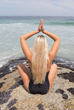 Blonde Doing Yoga Pose On The Beach Royalty Free Stock Photography