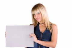 Blonde dolce in un vestito del denim con uno strato Immagine Stock Libera da Diritti