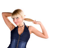 Blonde douce sur un fond blanc dans le studio photographie stock