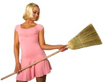 Blonde in dress and broom. Blonde dress and clean broom stock photography