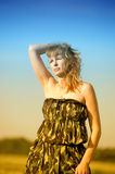 Blonde in a dress military Royalty Free Stock Photos