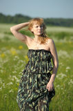 Blonde in a dress military Stock Photography