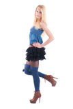 Blonde in a dress playfully posing Royalty Free Stock Image