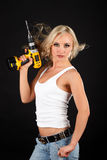 Blonde with drill. Royalty Free Stock Photography