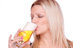 Blonde drinking beer Royalty Free Stock Images