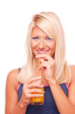 Blonde drinking orange juice Royalty Free Stock Photography