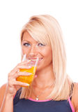 Blonde drinking orange juice Stock Photos