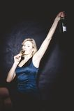 Blonde drinking Sparkling Wine Royalty Free Stock Photography