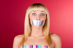 Blonde with duct tape on her lips Royalty Free Stock Photography