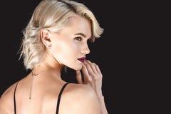 Blonde elegant girl, isolated. On black royalty free stock photography